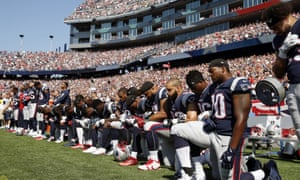 New England Patriots players take a knee.
