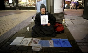 Skar Bantges with his artwork on the streets of Birmingham city centre.