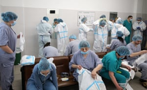 Moscow, Russia: staff members put on protective suits before entering the 'red zone' of a temporary medical facility established for Covid-19 patients