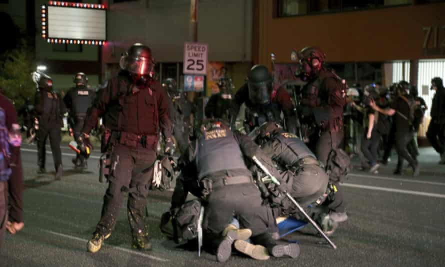 Portland police and demonstrators on Tuesday.