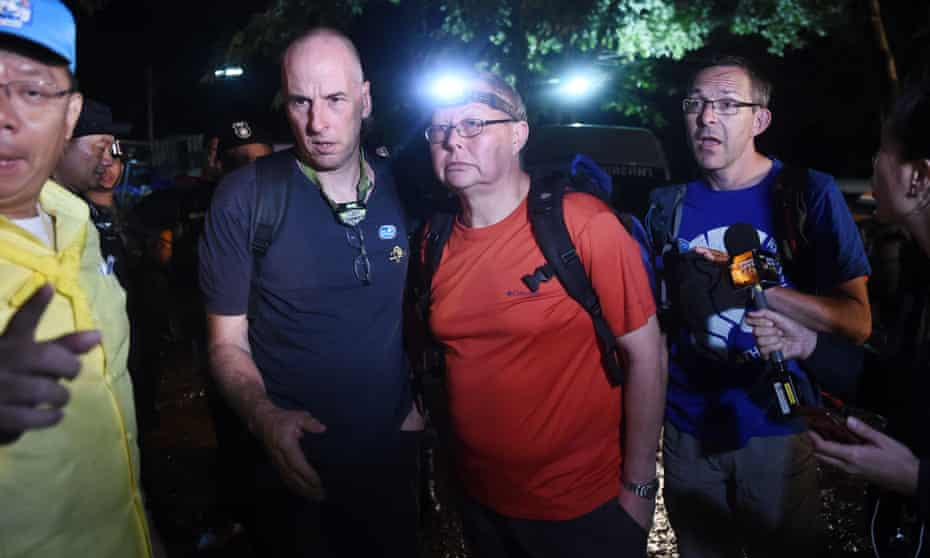 British cave divers Richard Stanton (2nd-L), Robert Charles Harper (3rd-L) and John Volanthen (R) arrive near the Tham Luang cave to join the search for the trapped boys