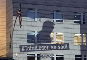 A Greenpeace banner showing Donald Trump and the slogan '#TotalLoser, so sad!' is projected on to the facade of the US embassy in Berlin, Germany