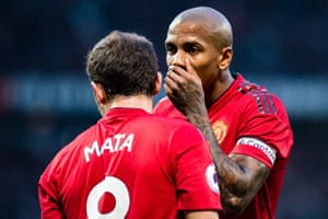 Head to head: Ashley Young and Juan Mata of Manchester United try to work out how to beat lowly Crystal Palace – the sides drew 0-0
