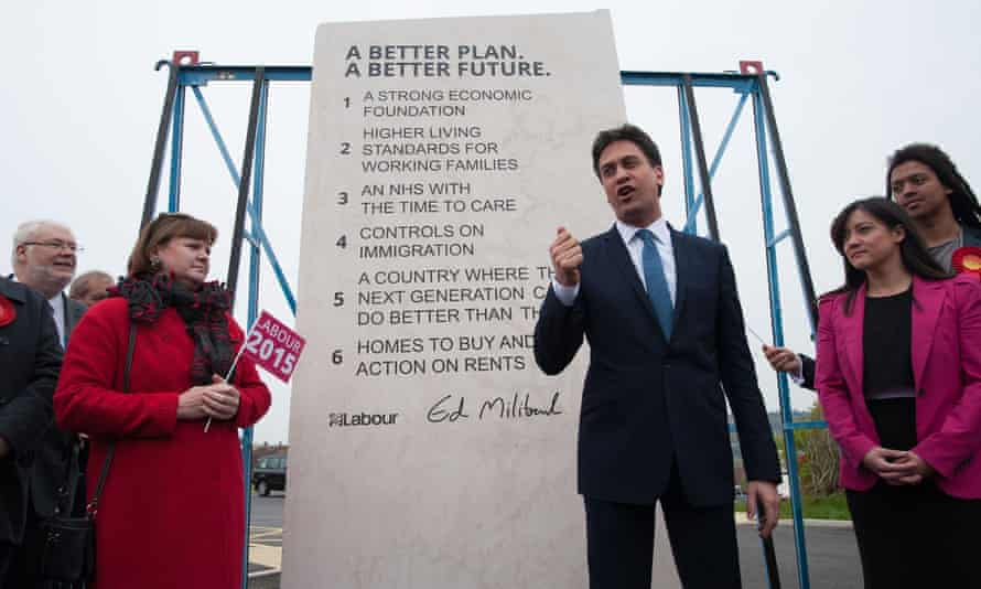 Ed Miliband unveils Labour's pledges carved into a stone plinth in Hastings during election campaigning