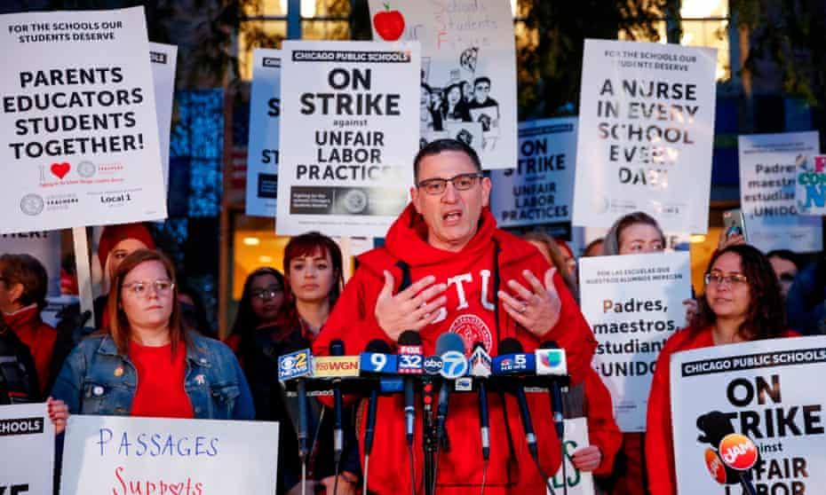 Chicago Teachers Union's president, Jesse Sharkey, speaks outside Peirce elementary school on Thursday in Chicago, Illinois.