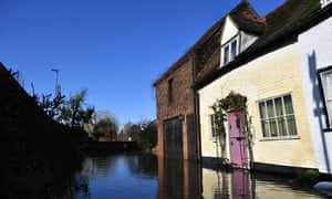 A cottage is reflected in flood water in Tewkesbury, Gloucestershire.