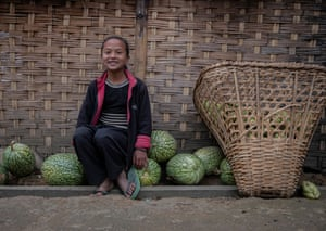 Girl, smiling, with melons and big wicker basket