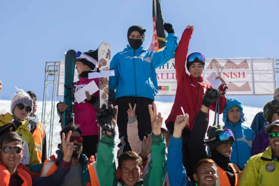 Nazira, who came first, stands triumphant on the podium after the women's race of the Afghan Ski Challenge.