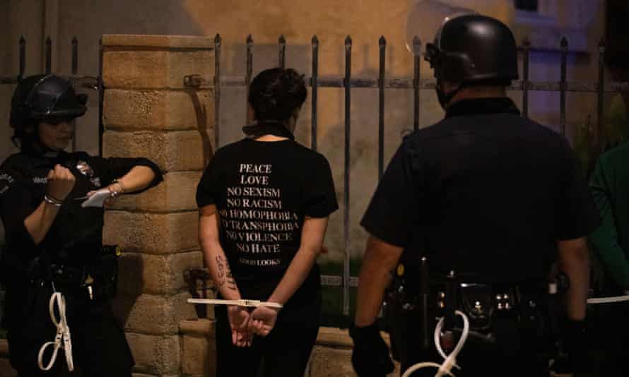 Los Angeles police arrest protesters for curfew violation after a day of peaceful protests against police brutality.