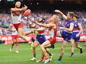 Jarrad McVeigh of the Swans attempts to mark .