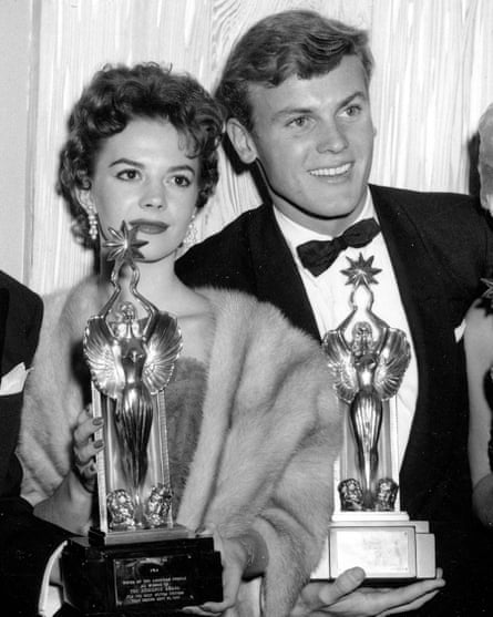 Natalie Wood and Tab Hunter pose with trophies at the Audience Awards in Los Angeles on 6 December 1955.