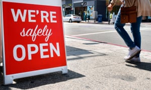 """A sign in Los Angeles announces that a restaurant is """"safely"""" open."""