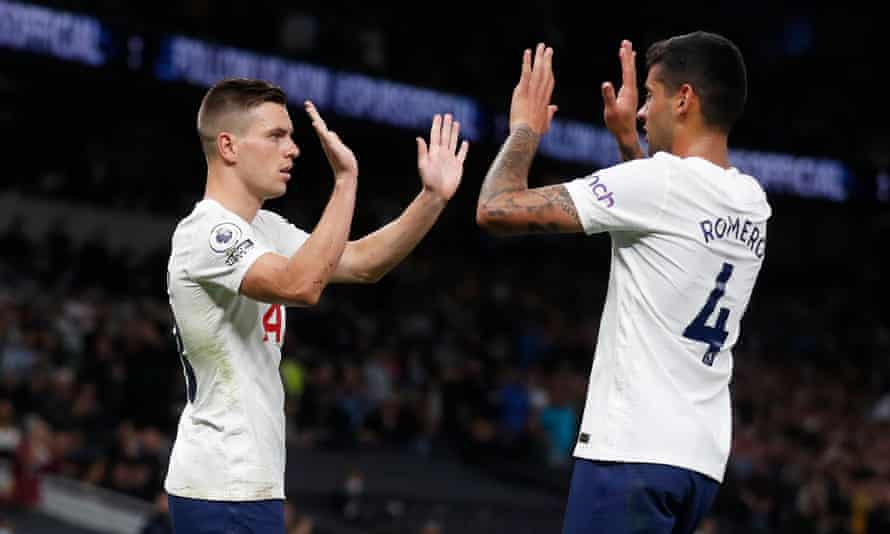 Giovani Lo Celso is congratulated by Cristian Romero after scoring Tottenham's third goal against Paços de Ferreira