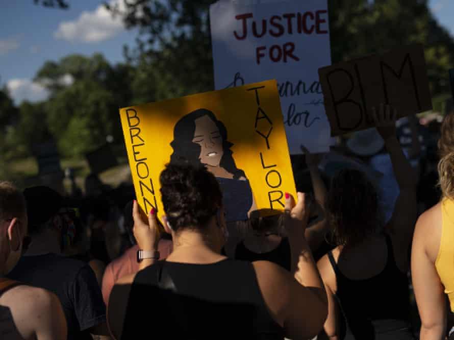 Demonstrators march through Powderhorn park on 26 June in Minneapolis, Minnesota, in honor of Breonna Taylor.