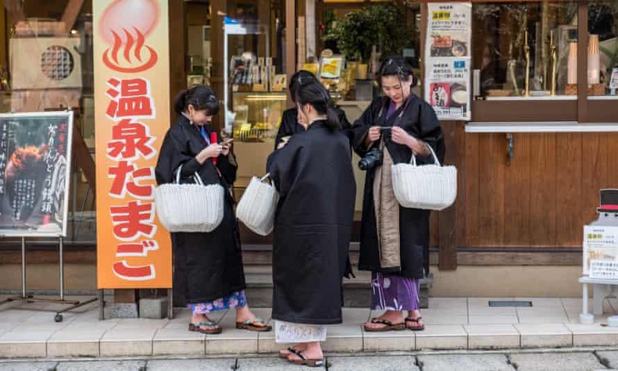 Yukata-clad bathers in Kinosake Onsen spa town.
