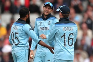 Adil Rashid celebrates with Joe Root and Eoin Morgan after taking the wicket of Asghar Afghan.