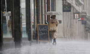A shopper caught in the rain on Oxford Street, central London