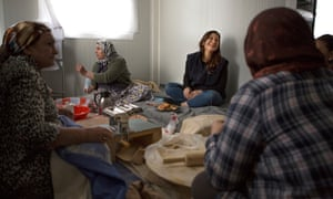 Writer Dina Nayeri (third from left) with women at Katsikas refugee camp in Greece