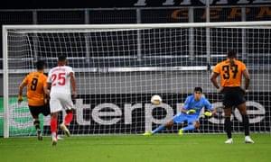 Adama Traoré watches on as Raúl Jiménez sees his early penalty saved by Yassine Bounou of Sevilla.