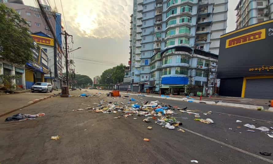 Protesters throw the garbage on the road as a protest against the military coup in Yangon