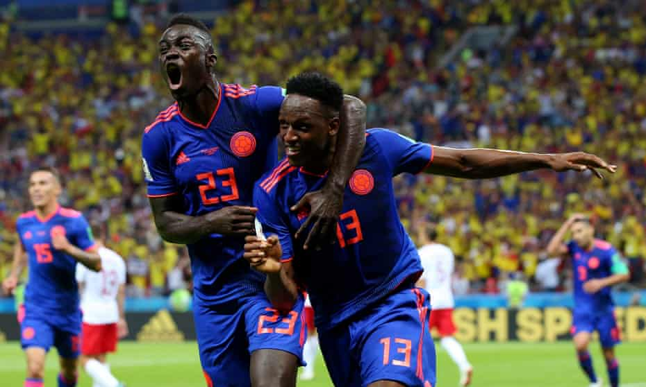 Yerry Mina celebrates with Davinson Sánchez after scoring Colombia's first goal in their emphatic victory against Poland in Group H.