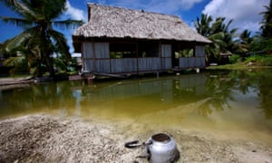 An abandoned house that has been affected by sea-water during high tides near the village of Tangintebu in the central Pacific Island nation of Kiribati.