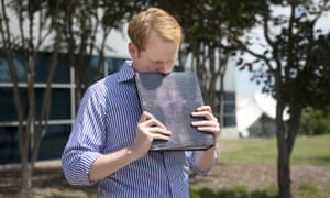 WDBJ news anchor Chris Hurst pauses as he is overcome with emotion while holding a photo album that was created by fellow reporter and girlfriend Alison Parker, in Roanoke, Virginia, in August 2015.