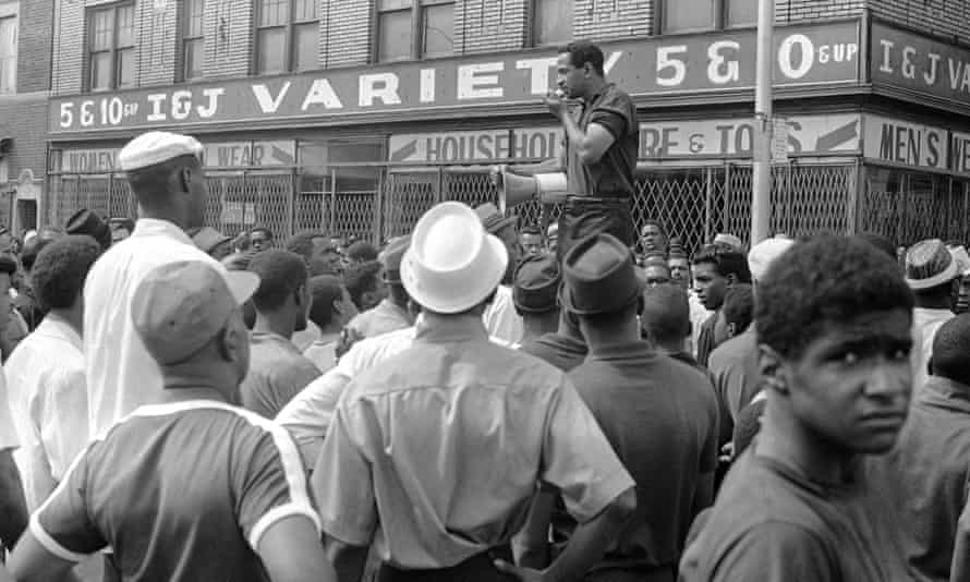 On 23 July 1967, Conyers uses a bullhorn to encourage African Americans in Detroit's riot area to go home.