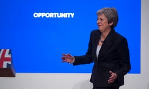 The prime minister, Theresa May, dances as she arrives on stage to make her speech at the Conservative Party annual conference in 2018