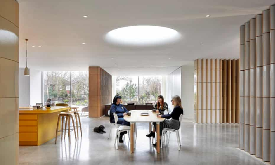 An oculus brings a disc of sunlight into the middle of the building's central space.
