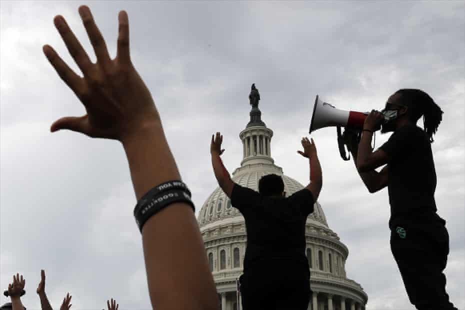 Demonstrators protest the death of George Floyd as they gather on the East side of the US Capitol in Washington on 3 June 2020.