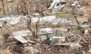 A man looks what is left of his home in Cake Bay, Saint Maarten