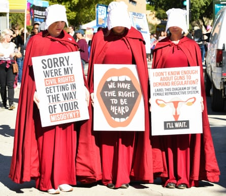 Three women's rights campaigners dressed as characters from The Handmaid's Tale at a Women's March in Los Angeles, California, on January 19 2019