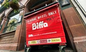 The logo of waste management company Biffa is seen on a large wheelie bin outside a pub in London.