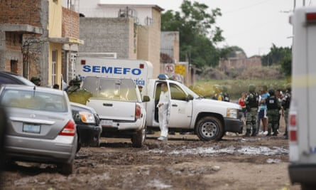 Members of the National Guard and medical staff are seen outside the rehabilitation center attacked by armed assailants in Irapuato, Guanajuato, Mexico on Wednesday.