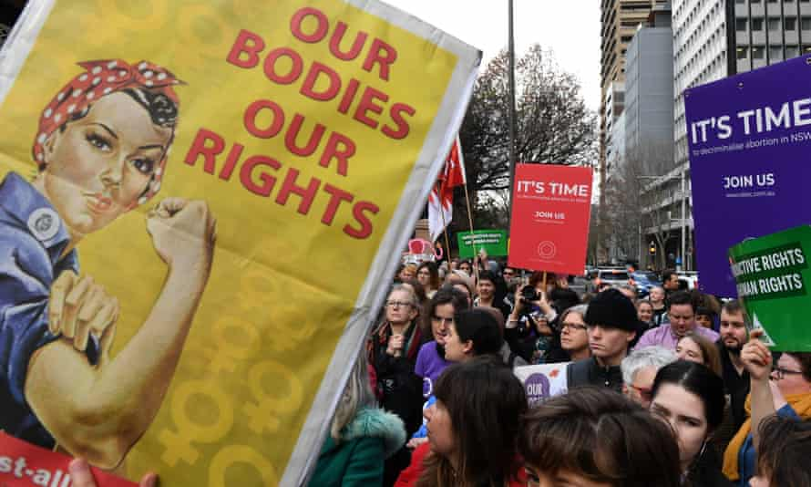 Pro-choice advocates and supporters of a bill to decriminalise abortion hold a rally outside the NSW parliament in Sydney on Wednesday.