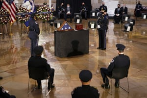 Guests are seated during a ceremony memorializing Capitol Police officer Brian Sicknick in the Capitol Rotunda.