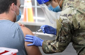 A man receives a shot at the FEMA-supported COVID-19 vaccination site at Valencia State College in Orlando.
