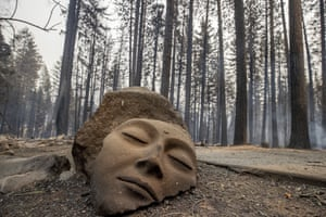 A sculpture rests in front of a Grizzly Flats home destroyed by the Caldor fire.