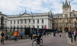 Cycling on Kings Parade in central Cambridge