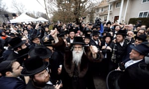 Rabbi Chaim Rottenberg leads the inauguration of a Torah scroll ceremony outside his home in Monsey, New York, on Sunday following the attack