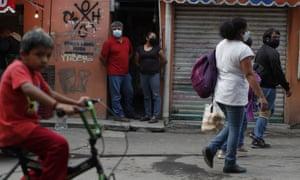 People wearing masks in San Gregorio Atlapulco in Mexico City.