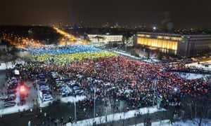 Protesters numbering in the tens of thousands gathered again on Sunday outside the Romanian government's offices to demand the resignation of the country's leadership.