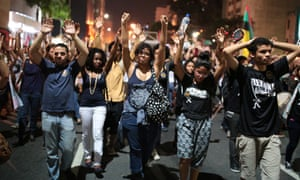 Marchers in Sao Paulo protest against racism and allegedly racially-motivated police killings .