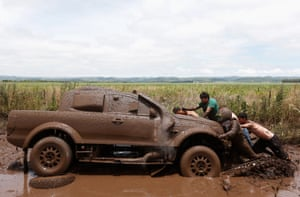 DMAS South Racing's Xavier Pons and Adrian Ricardo Torlaschi are helped by spectators after getting their Ford Ranger stuck in the mud
