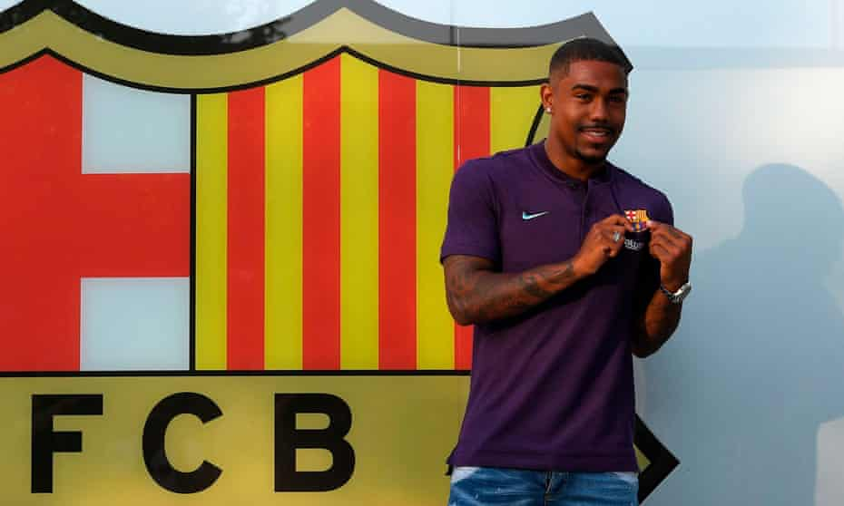 Malcom poses outside the Camp Nou after agreeing a five-year contract to join Barcelona.