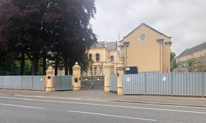 A security wall is being built around the Chinese consulate in Belfast