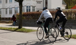 People ride bicycles in Aarhus, Denmark, where a strict lockdown has been relaxed.