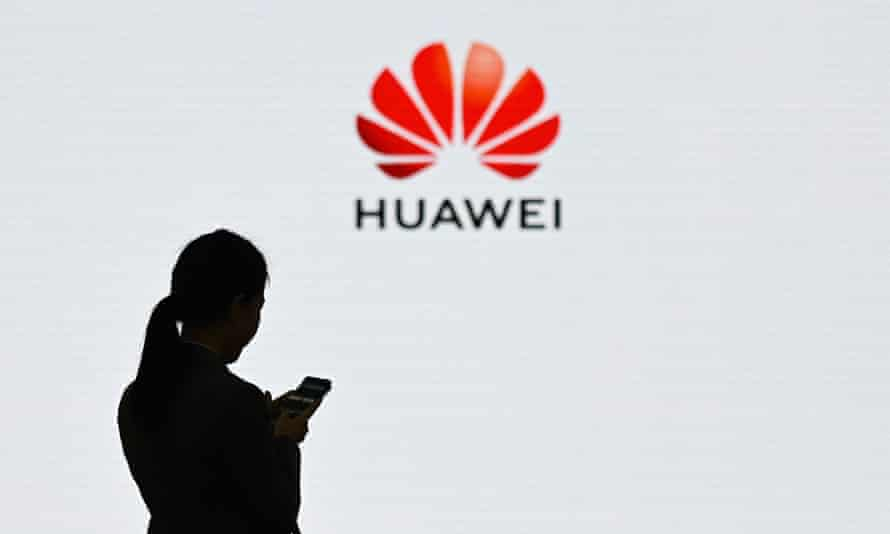 Huawei logo with woman on phone in front of it