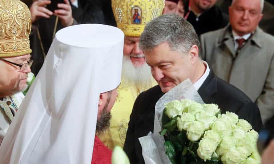 President Petro Poroshenko, right, greets Epiphanius I, the head of the Ukrainian Orthodox church, at St Sophia Cathedral in Kiev.